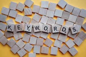 "Scrabble tiles spelling the word ""keywords""."