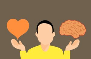 A cartoon person with a heart in one hand and a brain in the other.