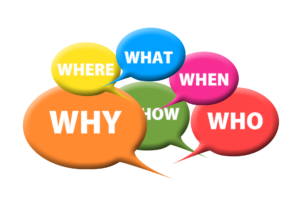 """Text bubbles with the words """"why"""", """"where"""", """"what"""", """"when"""", """"who"""", and """"how"""" written inside."""