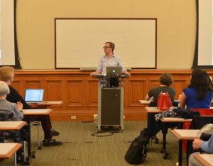 A man giving a speech in class