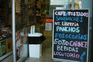 """Sign advertising """"cafe tostados sandwiches art libreria"""""""