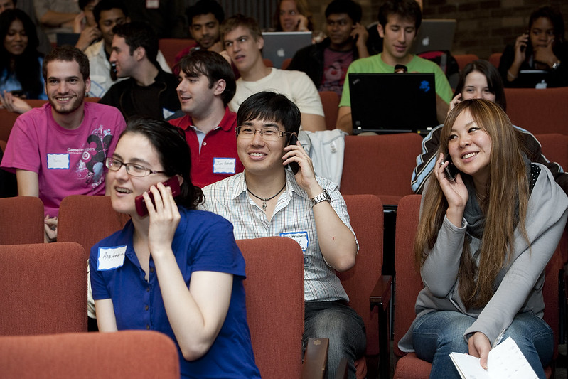 Several students talking on the phone
