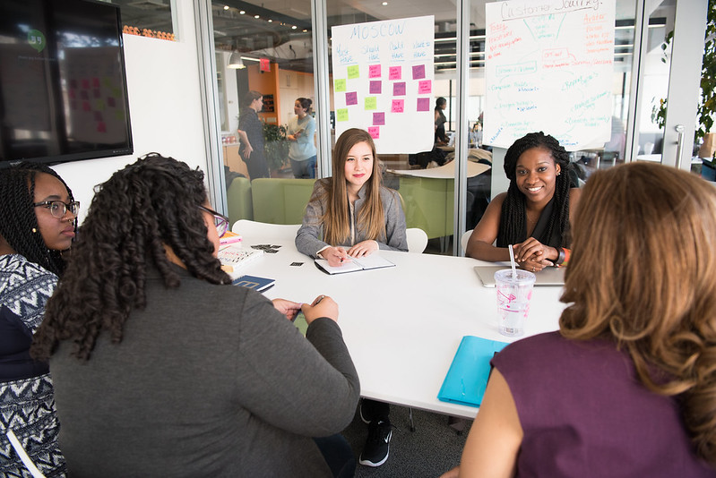 Women in a discussion in a board room