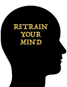 "silhouette of a person's head with the words ""Retrain your mind"""