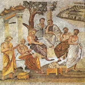 Tile mosaic depicting several male figures in togas outside, under columns and trees