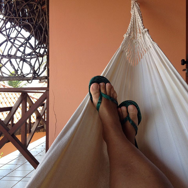Feet propped up in a hammock