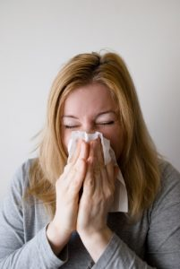 Woman holding a handkerchief to her nose