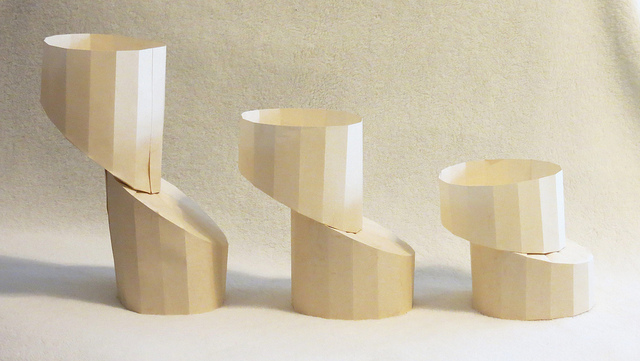 Three columns of folded paper. Each is split lengthways and the top half is shifted slightly left