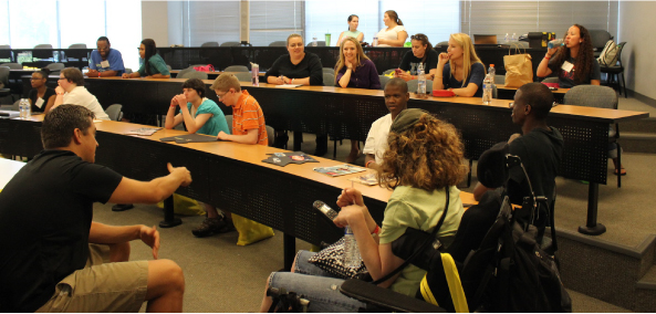 A photograph shows students in a classroom.