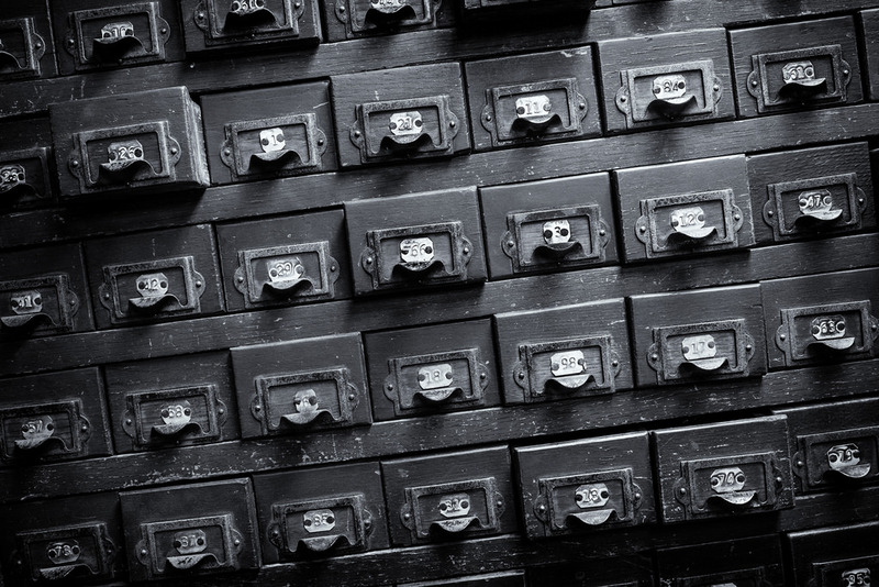 Photograph of an old card catalog filing system.
