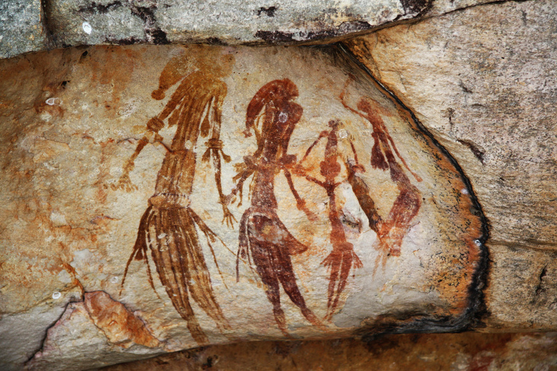Cave drawings of people.