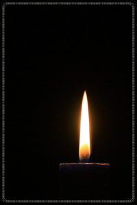 small candlelight with black background.