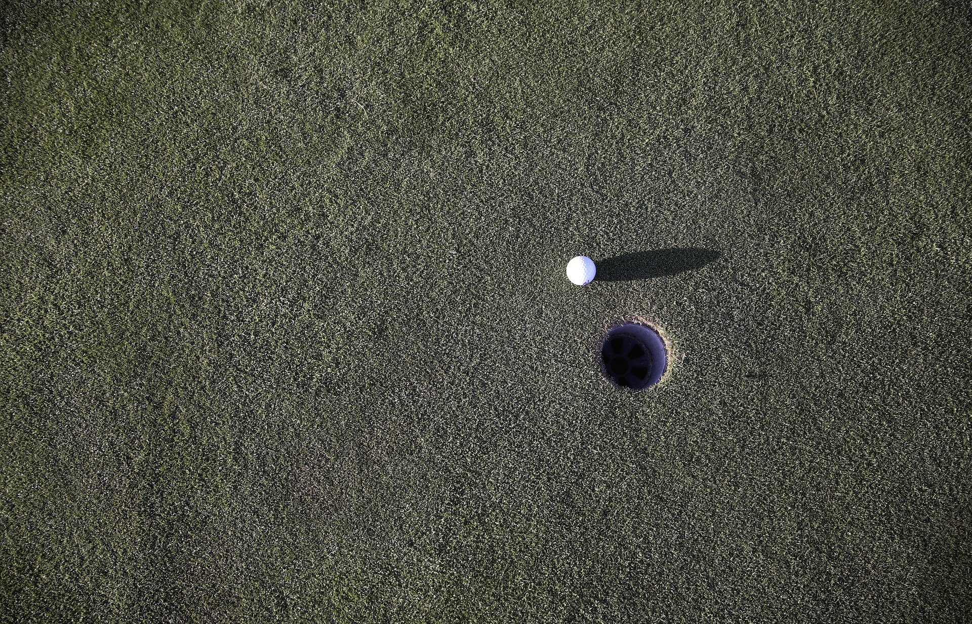 aerial view of a golf hole and golf ball
