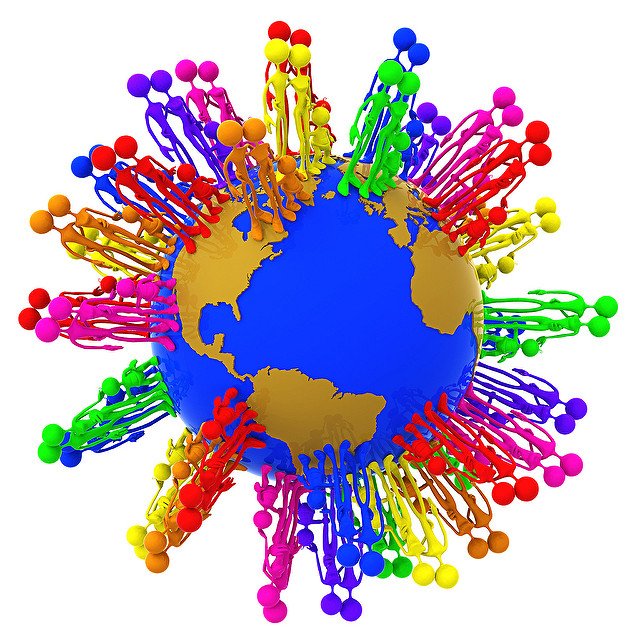 Computer generated image of the earth with groups of people standing around. Each group is a different color of the rainbow.