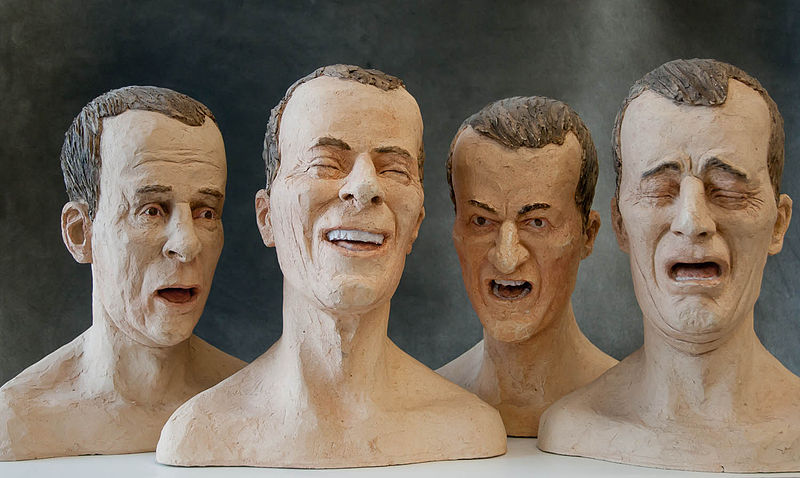 Four sculptures of a man showing four different expressions: fear, anger, contempt, and disgust.
