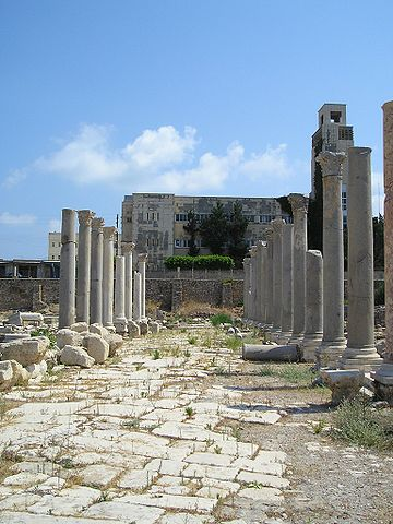 Photograph of ancient ruins, showing a rocky floor and pillars in a large open space.