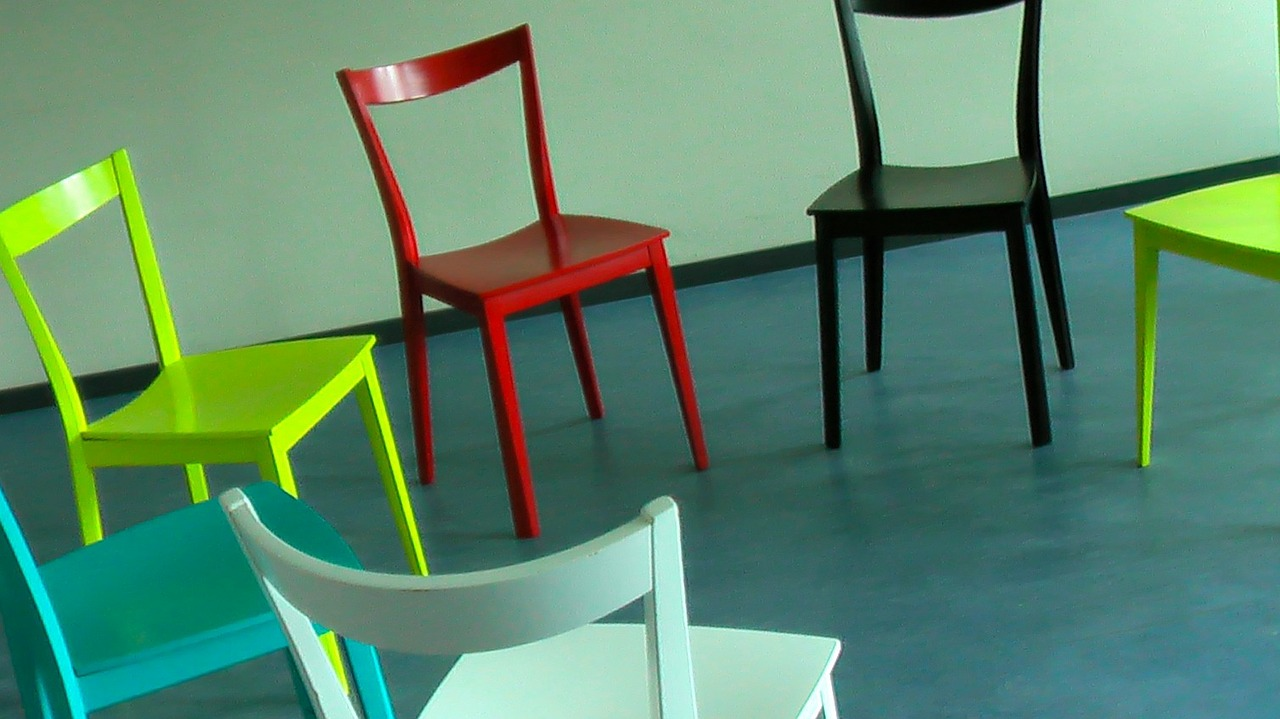 Colorful chairs set up in a circle for group therapy.