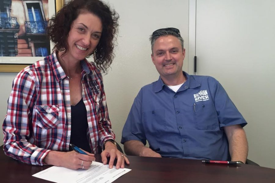 Russian River Brewing's Vinnie and and Natalie Cilurzo signing on a new property for their new brewery.