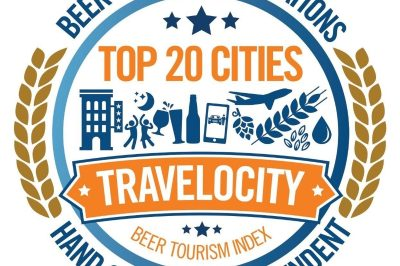 Travelocity Beer Tourism Logo