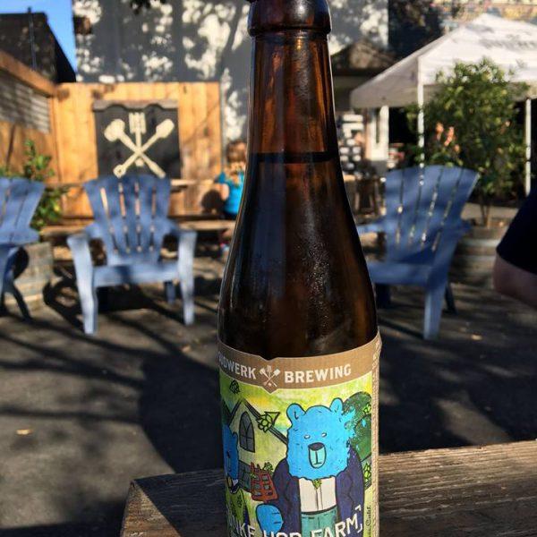 Fünke Hop Farm bottle on table outside.