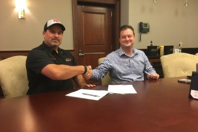 Jeremy Warren, CEO/Brewmaster of Revision Brewing Company and Michael Hayek, Statewide Beer Division Manager at Mutual Distributing Company, Sign Distribution Agreement