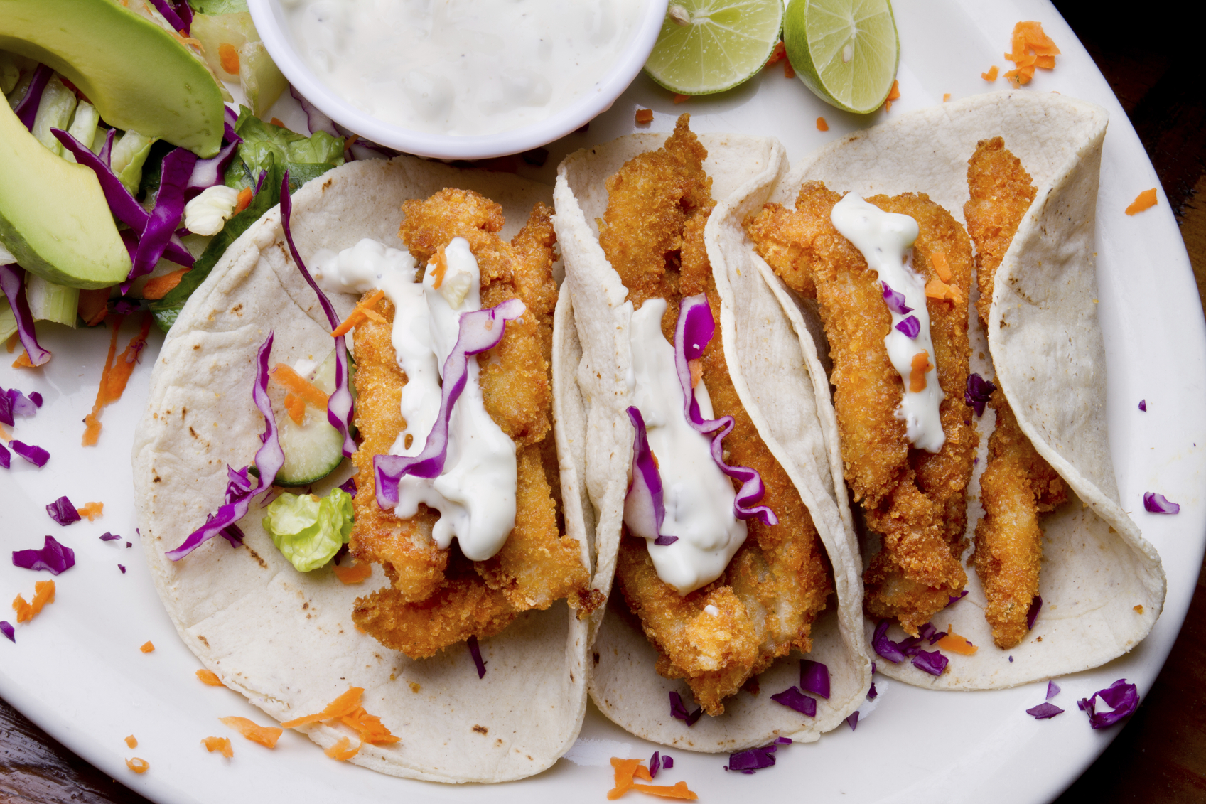 beer battered fried avocado tacos with sriracha curtido