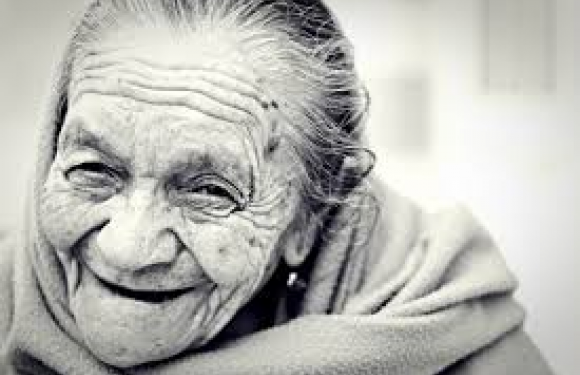 I love this lady's expression! Wrinkles, gray hair and a smile.