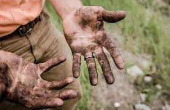 Mud covered hands