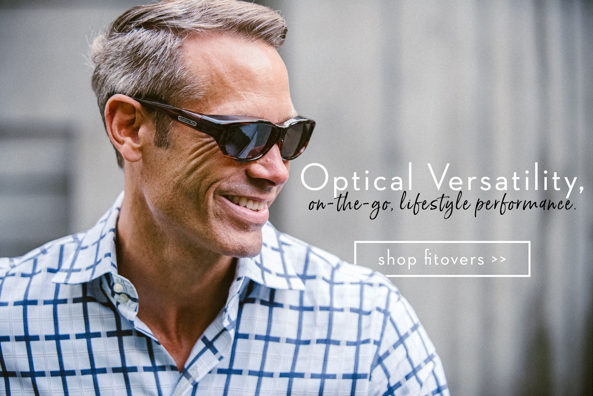 A man wearing sunglasses by Jonathan Paul designed to fit over prescription eyewear