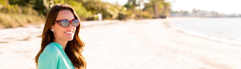 Ikara Fitover Premium Sunglasses worn by women on beach