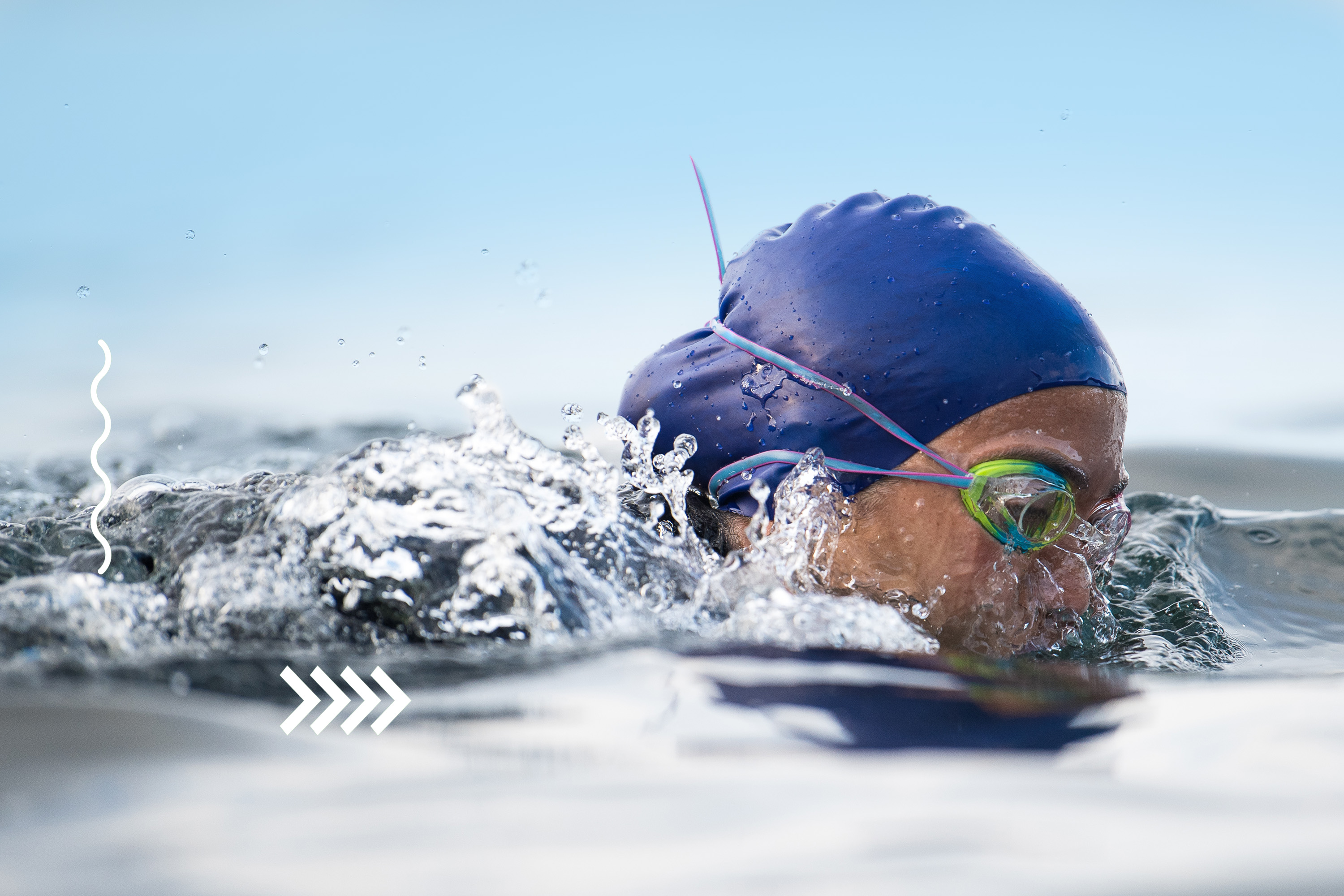 A women wearing swim goggles in the water