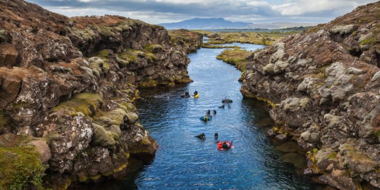 Divers snorkel between two continents in Iceland