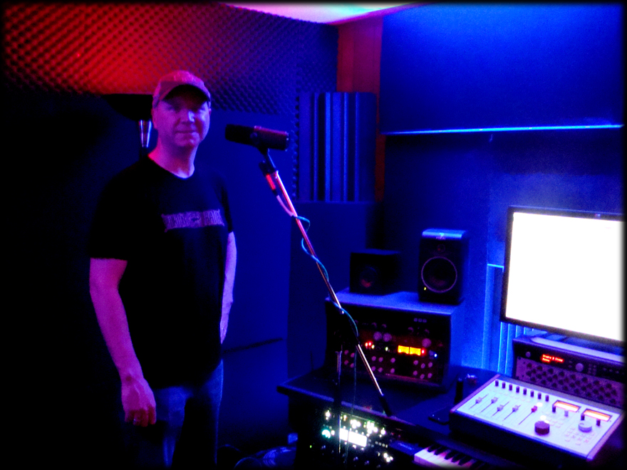 Monty Leach recording scratch vocals in the control room
