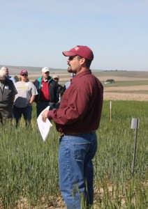 Mike Pumphrey speaking to a crowd at a field day