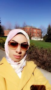 Fatimah Aljaafar with a brick building in the background