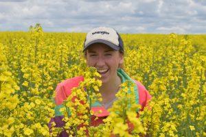 Rachel Breslauer in a canola field