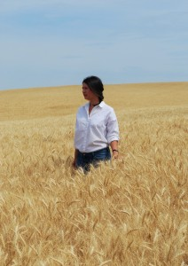 Shantel Martinez standing in a wheat field