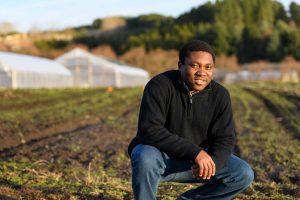 Cornelius Adewale in a field