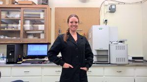 Jessica Braden in her lab standing in front of her sampling equipment