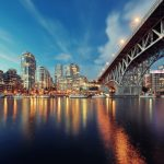 Vancouver-False-Creek-at-night-with-bridge-and-boat-Canada