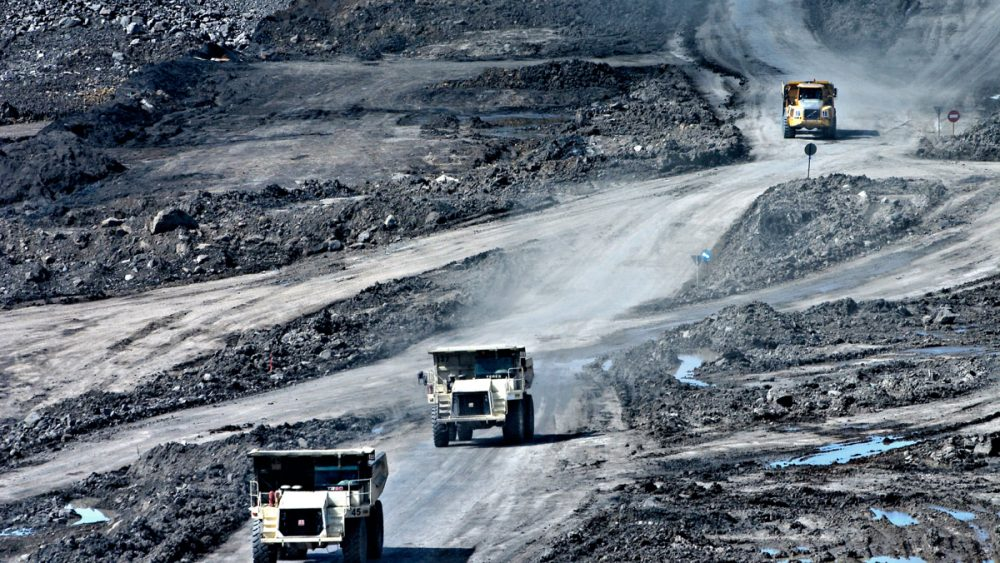 Land rovers driving through Canada's mining landscape