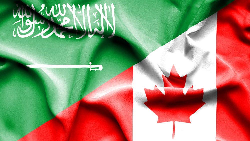 Saudi Arabia flag and Canadian flag
