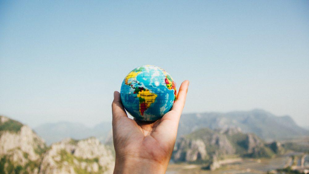 miniature globe in hand