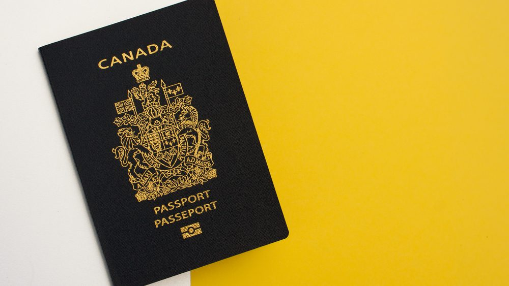 Canadian Passport on yellow and white background
