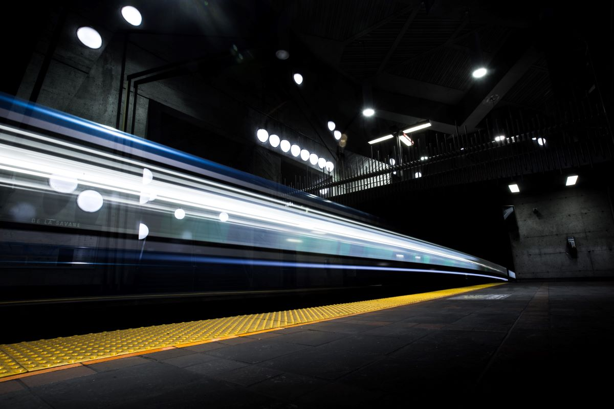 Blue speeding underground train on platform