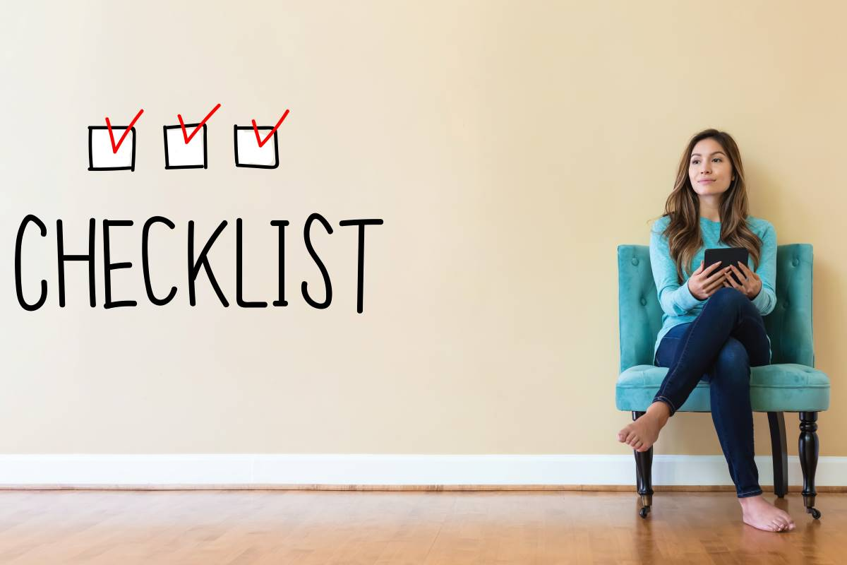 woman sitting on chair with checklist to move to Canada