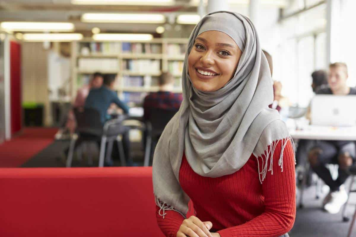beautiful Muslim women in university library | immigrate to Canada