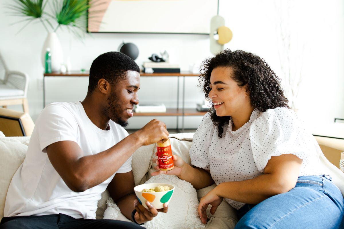 Couple sharing food on a couch