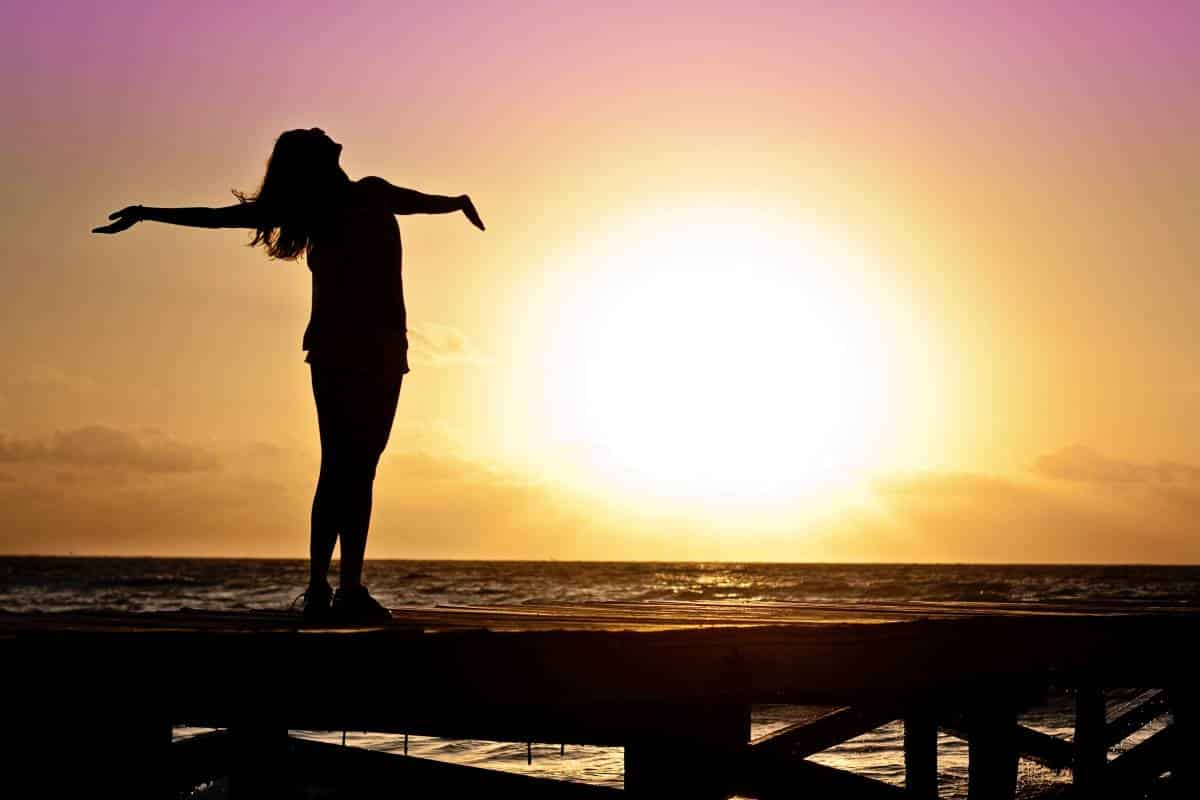 woman on beach at sunset bright future concept | 10 reasons to Apply for a Canada Visa in 2020
