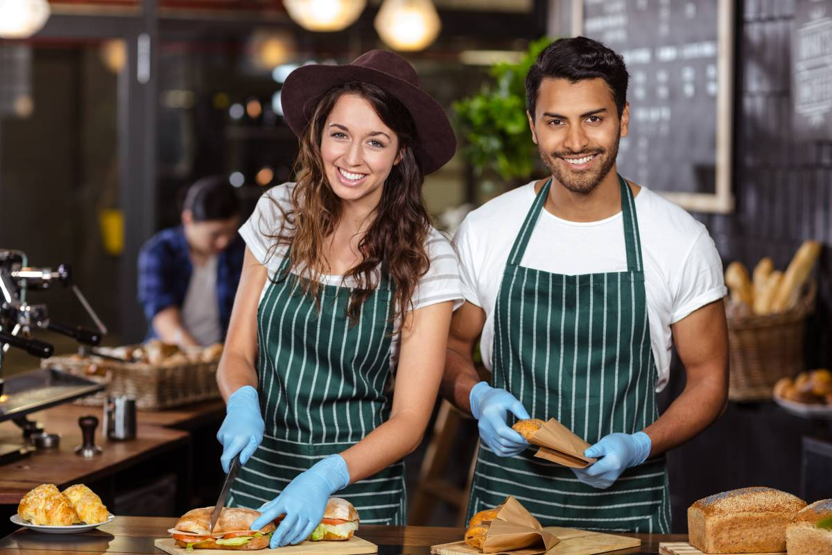 smiling-students-working-as-servers-in-restaurants | study in Canada